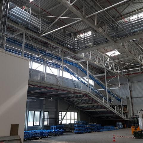 KUHN CLC – Centre logistique avec magasin grande hauteur et unité de grenaillage. Environ 1400T de charpente
